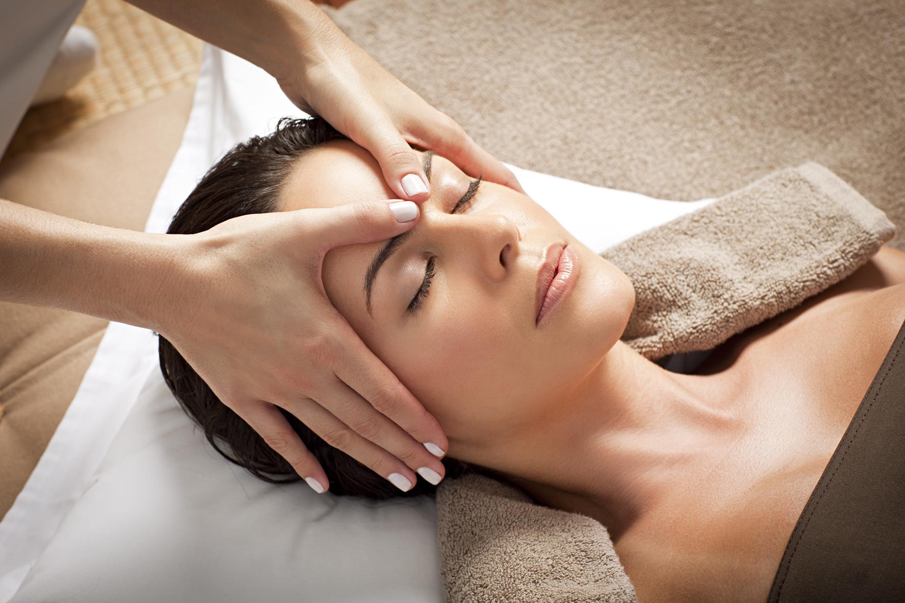 woman at spa receiving facial