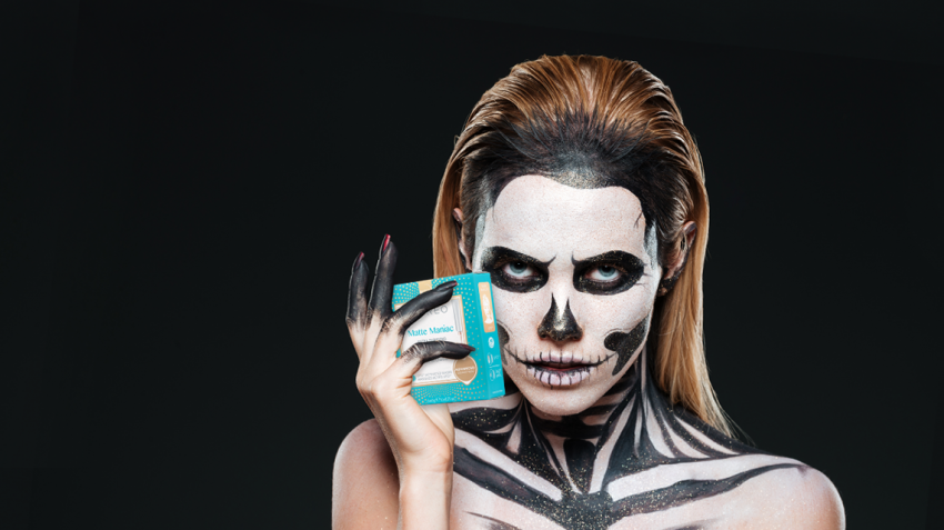 girl with skeleton halloween makeup holding foreo ufo mask matte maniac