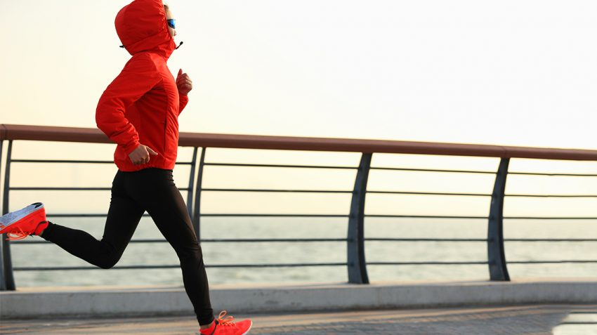 Girl jogging during cold winter morning