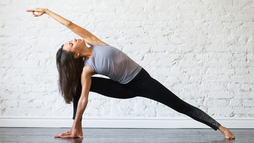 Girl doing Yoga practice at home