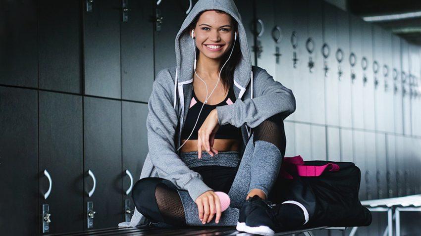 Girl holing LUNA 2 at the Gym locker room