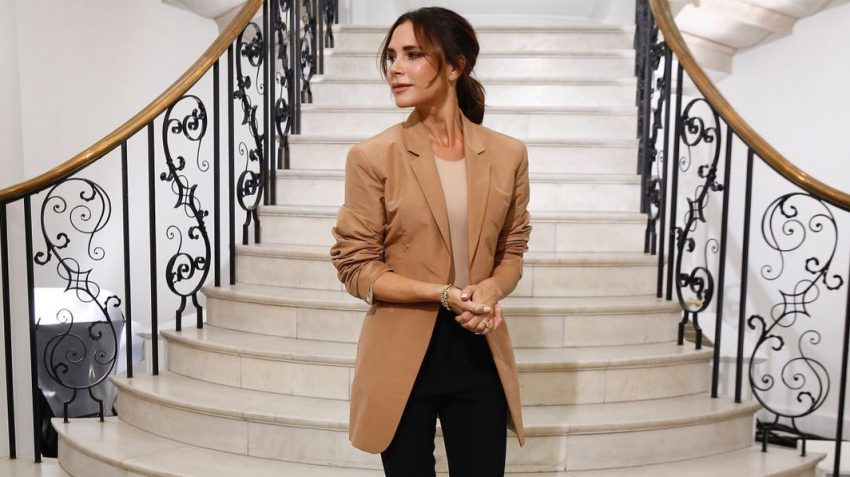 Victoria Beckham on a staircase at fashion show