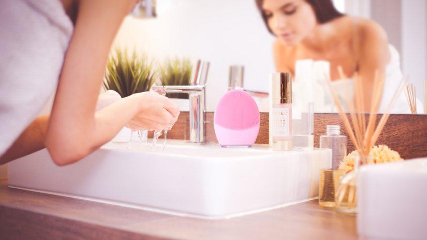 girl washing her face