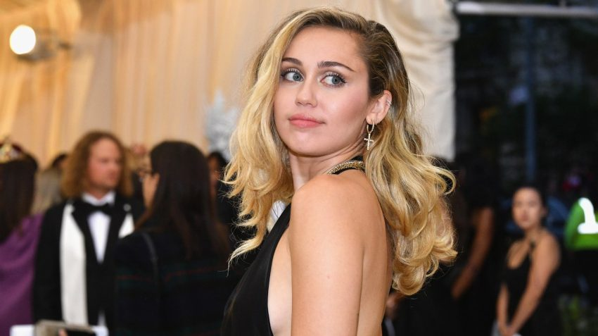 Miley Cyrus in black backless dress