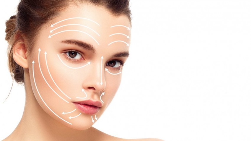 Woman's face with points of facial massage drawn on