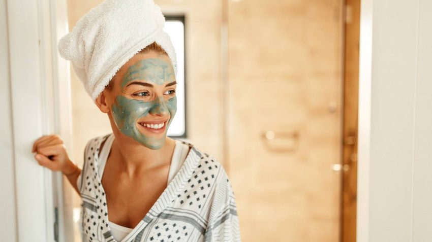 Woman Wearing Clay Mask Smiling